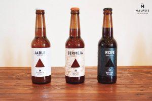 Botellas de cerveza Malpeis en Marca Canaria